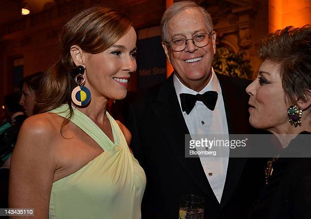 David Koch executive vice president of chemical technology for Koch Industries Inc center and wife Julia Flesher left speak with a guest during the...