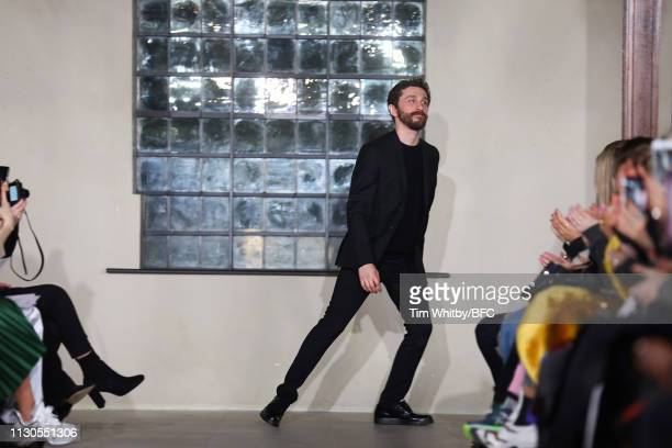 David Koma walks the runway at the David Koma show during London Fashion Week February 2019 at the St George's Church Bloomsbury on FEBRUARY 18 2019...