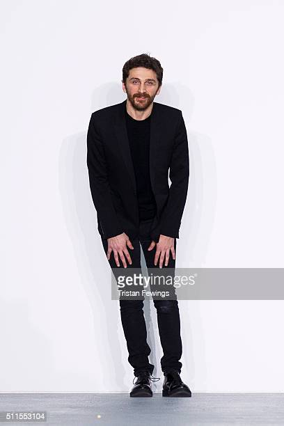 David Koma walks the runway at the David Koma show during London Fashion Week Autumn/Winter 2016/17 at Brewer Street Car Park on February 21 2016 in...