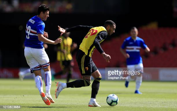 David Kownacki of Sampdoria and Etienne Capoue of Watford compete for the ball during the preseason friendly match between Watford and Sampdoria at...