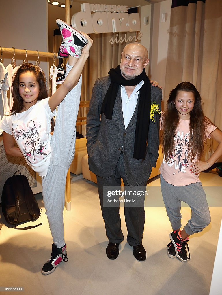 David Kramberg (Dimensione Danza Deutschland) poses with two youth dance performers during the 'Dimensione Danza' - Berlin store opening on March 8, 2013 in Berlin, Germany.
