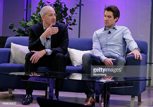 David Krantz chief executive officer of YP Holdings LLC left speaks as Mihael Miha Mikek cofounder and chief executive office of Celtra Inc listens...