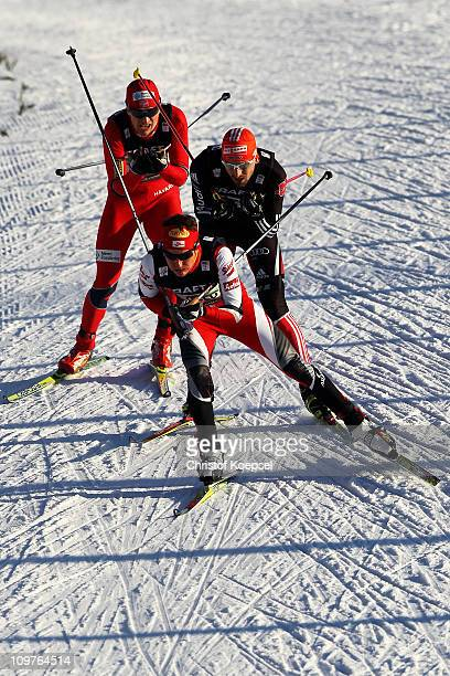 David Kreiner of Austria Bjoern Kircheisen of Germany and Haavard Klemetsen of Norway compete in the Nordic Combined Team 4x5km race during the FIS...