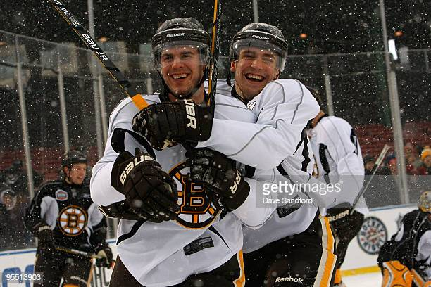 David Krejci and Blake Wheeler of the Boston Bruins joke around as they skate during practice prior to Bridgestone's presentation of 2010 NHL Winter...