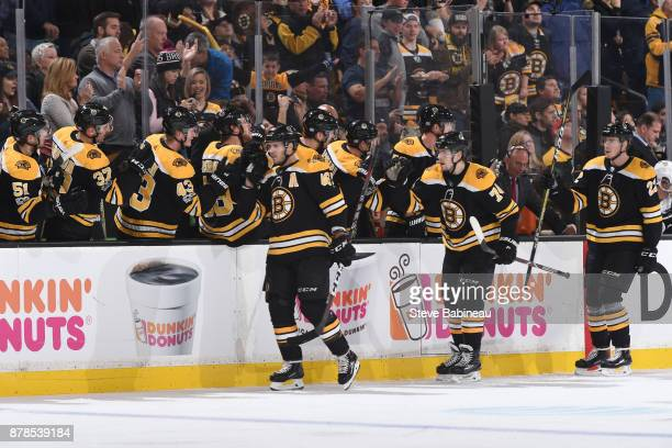 David Krejci Jake DeBrusk and Peter Cehlarik of the Boston Bruins celebrate a goal in the first period against the Pittsburgh Penguins at the TD...