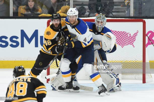 David Krejci of the Boston Bruins against Carl Gunnarsson and Jordan Binnington of the St Louis Blues in Game One of the Stanley Cup Final during the...