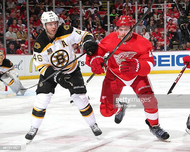 David Krejci of the Boston Bruins and Joakim Andersson of the Detroit Red Wings battle for position during Game Three of the First Round of the 2014...