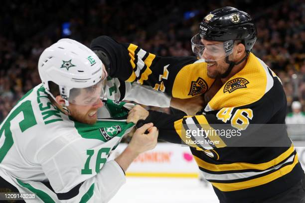 David Krejci of the Boston Bruins and Joe Pavelski of the Dallas Stars fight during the second period at TD Garden on February 27 2020 in Boston...