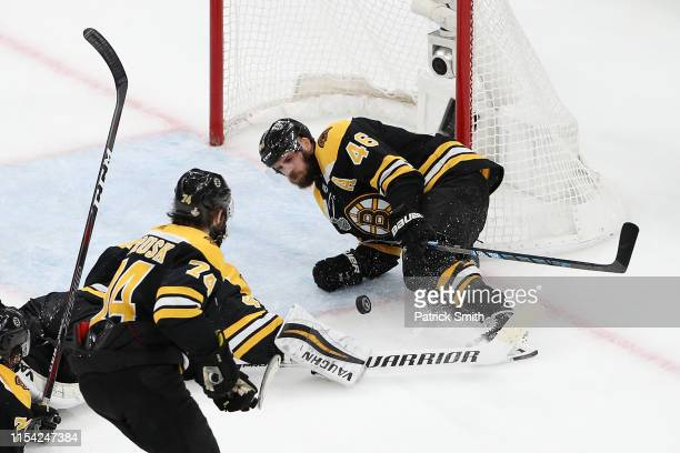 David Krejci of the Boston Bruins blocks a shot against the St Louis Blues during the second period in Game Five of the 2019 NHL Stanley Cup Final at...