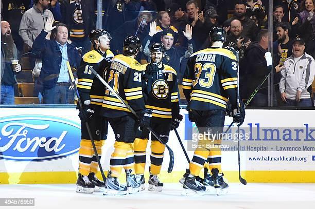 David Krejci of the Boston Bruins celebrates a goal against the Arizona Coyotes at the TD Garden on October 27 2015 in Boston Massachusetts