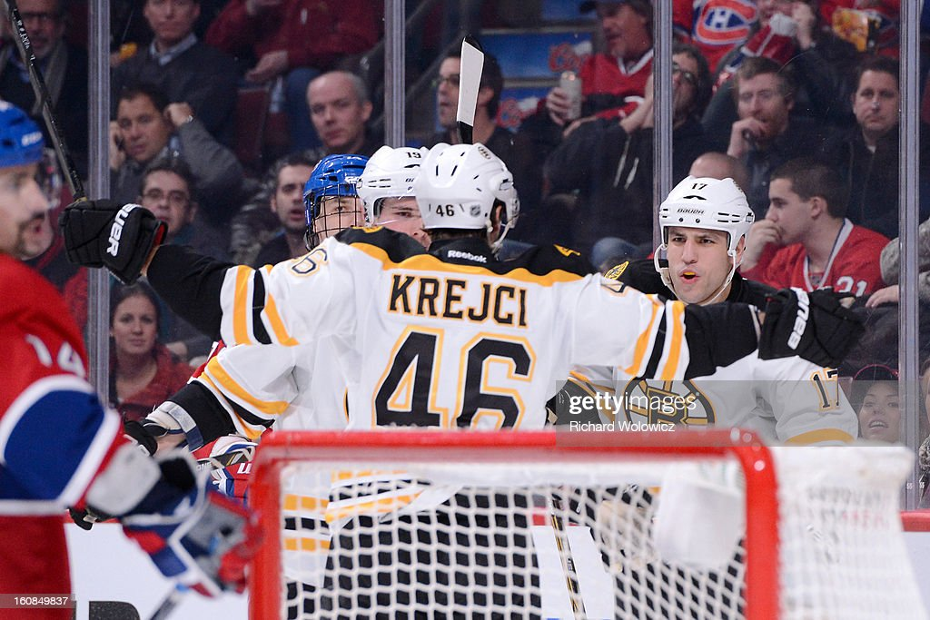 David Krejci #46 of the Boston Bruins celebrates his game-winning goal with teammates during an NHL game against the Montreal Canadiens at the Bell Centre on February 6, 2013 in Montreal, Quebec, Canada. The Bruins defeated the Canadiens 2-1.