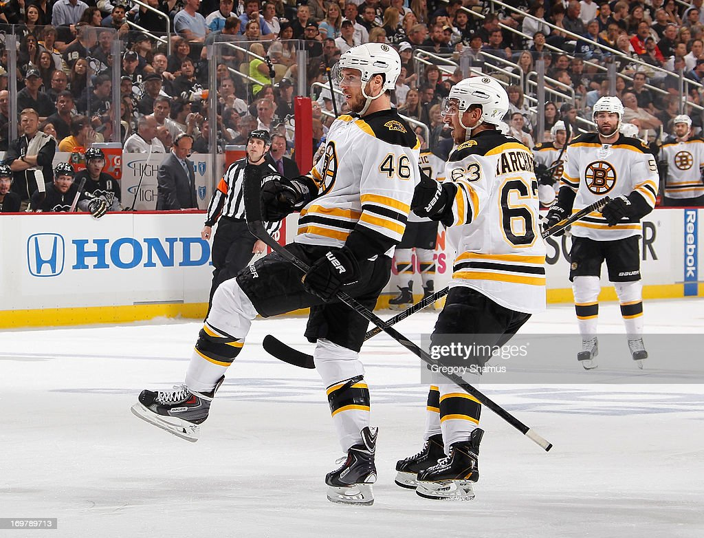 David Krejci #46 of the Boston Bruins celebrates his goal with Brad Marchand #63 during the first period against the Pittsburgh Penguins in Game One of the Eastern Conference Final during the 2013 NHL Stanley Cup Playoffs at Consol Energy Center on June 1, 2013 in Pittsburgh, Pennsylvania.