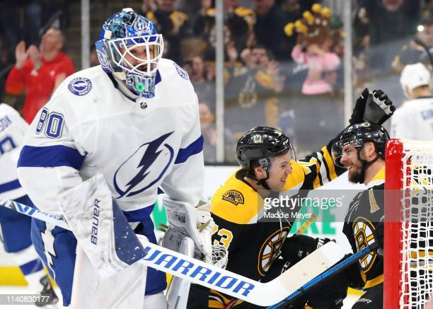 David Krejci of the Boston Bruins celebrates with Charlie McAvoy after scoring a goal against the Tampa Bay Lightning during the first period at TD...