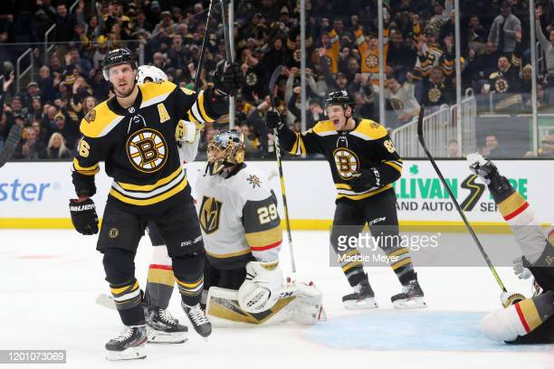 David Krejci of the Boston Bruins celebrates with Karson Kuhlman after scoring a goal against Marc-Andre Fleury of the Vegas Golden Knights during...