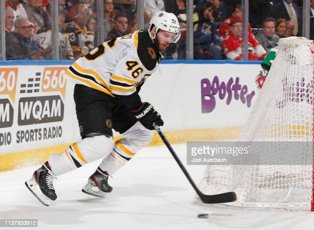 David Krejci of the Boston Bruins is unable to pass the puck in front of the Florida Panthers net during second period action at the BBT Center on...