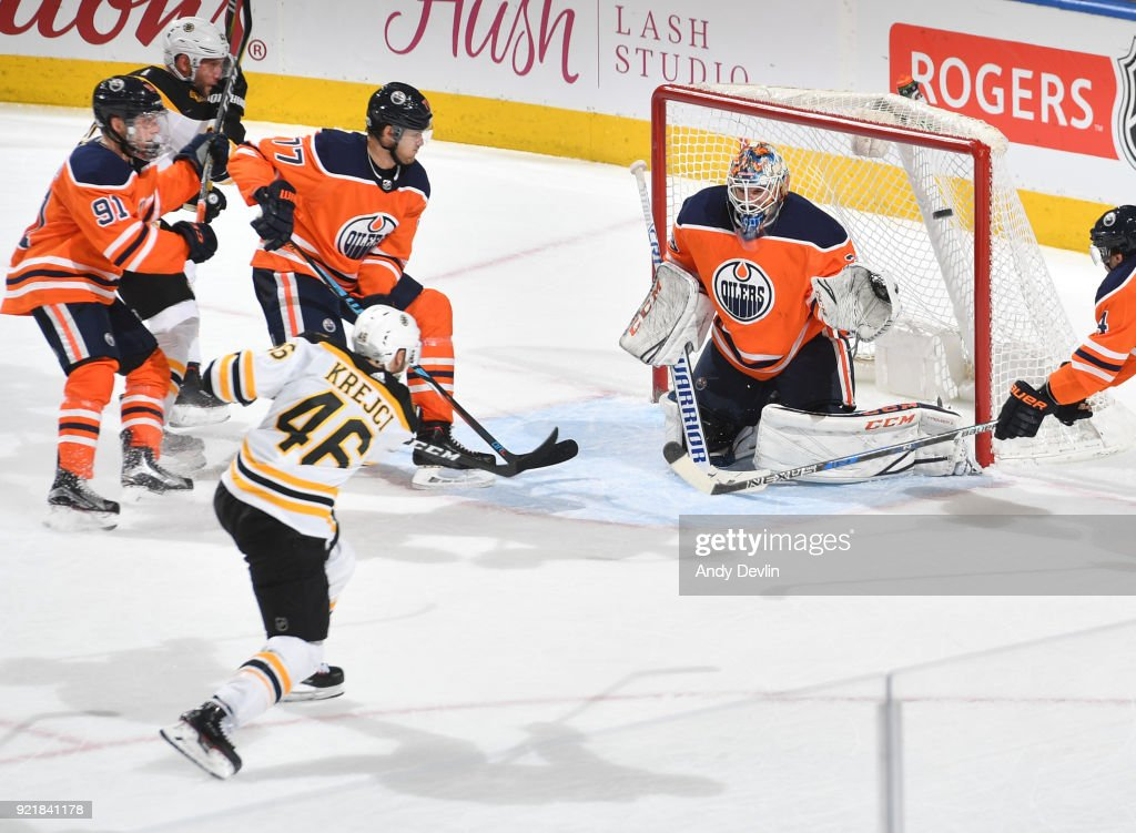 David Krejci #46 of the Boston Bruins scores a goal on Cam Talbot #33 of the Edmonton Oilers on February 20, 2018 at Rogers Place in Edmonton, Alberta, Canada.