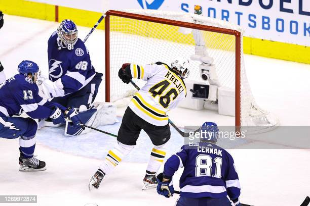 David Krejci of the Boston Bruins scores a tying goal past Andrei Vasilevskiy of the Tampa Bay Lightning during the third period in Game Five of the...