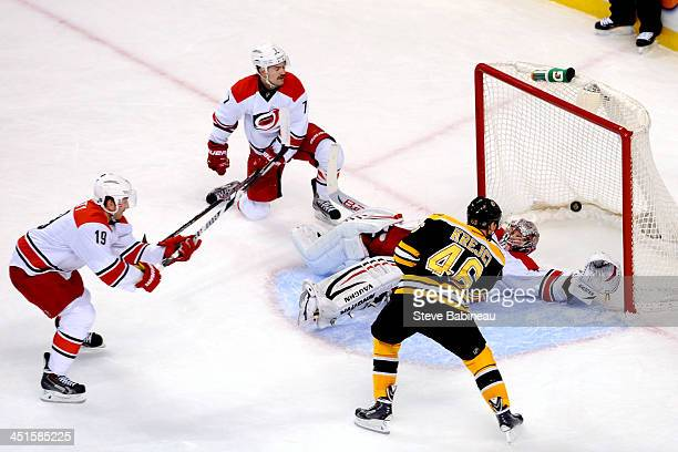 David Krejci of the Boston Bruins scores in overtime against the Carolina Hurricanes at the TD Garden on November 23 2013 in Boston Massachusetts
