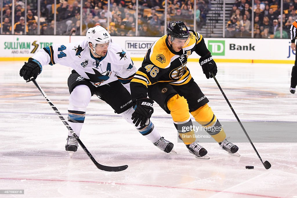 David Krejci #46 of the Boston Bruins skates with the puck against Marc-Edouard Vlasic #44 of the San Jose Sharks at the TD Garden on November 17, 2015 in Boston, Massachusetts.