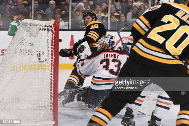 David Krejci of the Boston Bruins watches the puck go in the net for a goal against Cam Talbot of the Edmonton Oilers at the TD Garden on November 26...