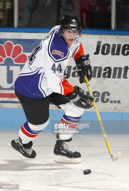 David Krejci of the Gatineau Olympiques moves the puck against the Baie-Comeau Drakkar at Centre Robert-Guertin on November 19, 2004 in Gatineau,...