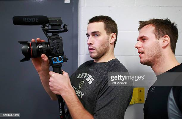 David Krejci watches Matt Bartkowski of the Boston Bruins film teammates playing soccer before their NHL game against the Vancouver Canucks at Rogers...