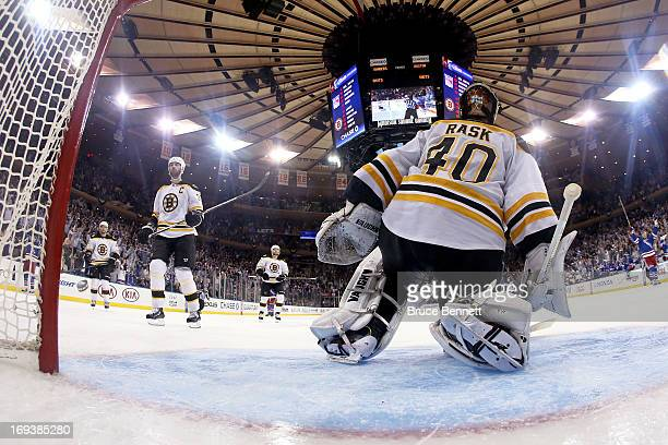 David Krejci Zdeno Chara Torey Krug and goalie Tuukka Rask of the Boston Bruins look on dejected as the New York Rangers celebrate their 43 overtime...