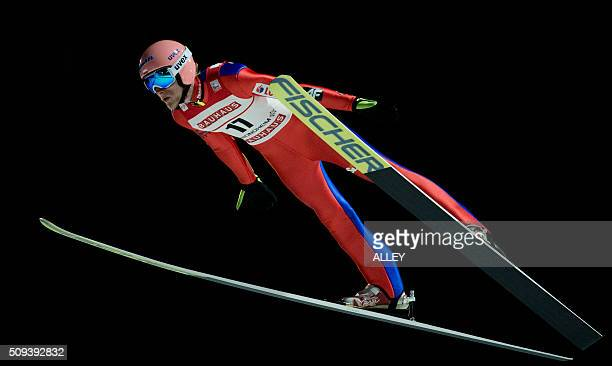 David Kubacki from Poland soars through the air during the FIS Ski Jumping World Cup competition in Trondheim on February 10 2016 / AFP / NTB Scanpix...