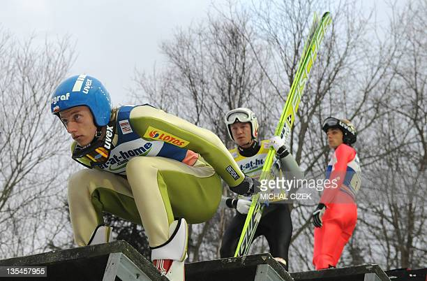 David Kubacki of Poland prepares for his trial jump to the Ski Jumping World Cup Team competition in Harrachov on December 10 2011 AFP PHOTO / MICHAL...