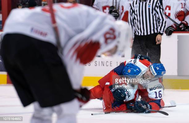 David Kvasnicka of the Czech Republic is congratulated by teammate Martin Kaut after scoring the game winning goal as Nando Eggenberger of...