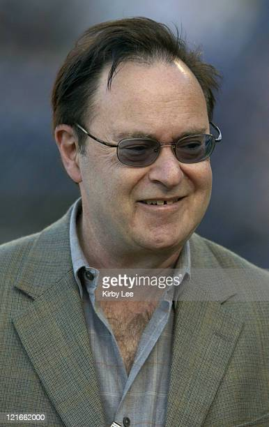 """David L. Lander, who played """"Squiggy"""" on the television sitcom """"Laverne and Shirley"""" watches batting practice before game between the Chicago Cubs..."""