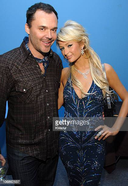 David LaChapelle and Paris Hilton during 14th Annual Elton John AIDS Foundation Oscar Party Co-hosted by Audi, Chopard and VH1 - Inside at Pacific...