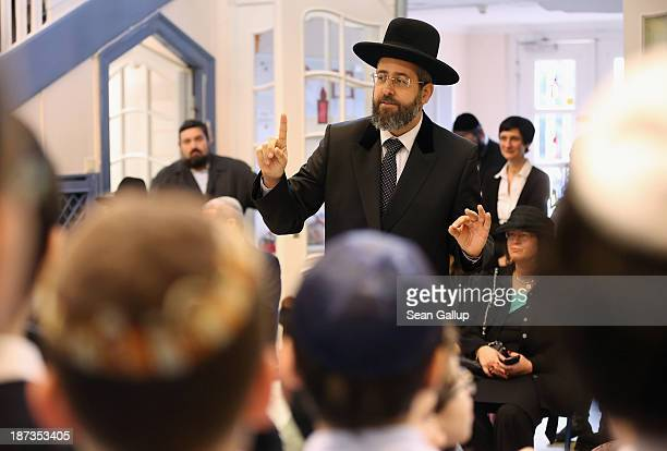 David Lau Ashkenazi Chief Rabbi of Israel speaks to children about the Kristallnacht pogroms at the Or Avner traditional Jewish school on November 8...
