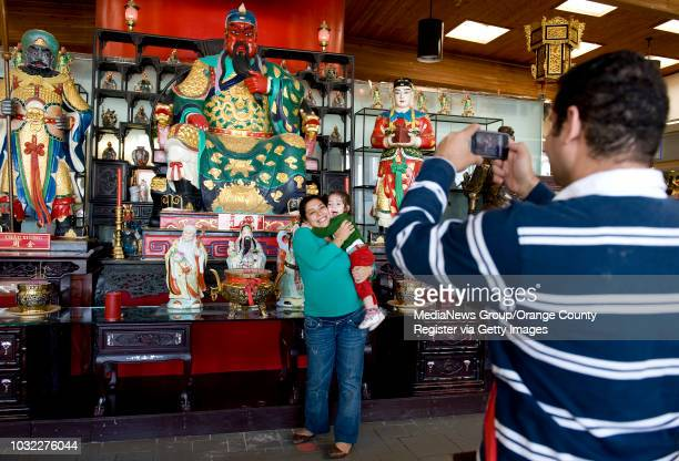 David Lawandy Anwer right of Qatar takes photos of his wife Silvia Mikhaeil and daughter Sandy Zogheib in the Asian Garden Mall in the Little Saigon...