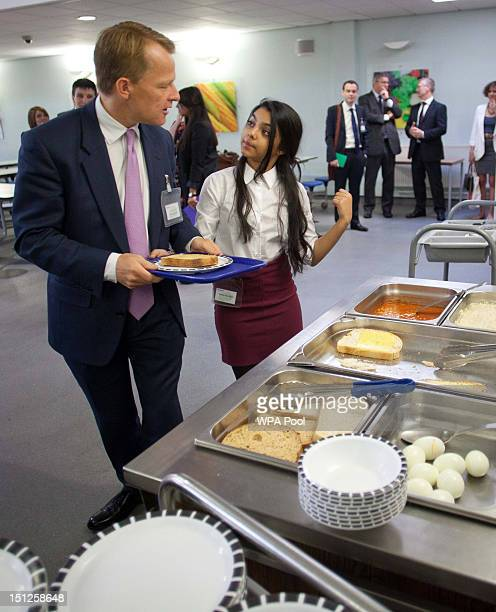 David Laws is seen in the canteen getting his breakfast during a visit school to Mulberry School for Girls in Tower Hamlets on Septemebr 5 2012 in...