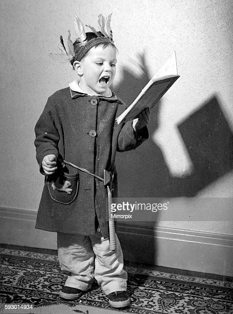 David Lea three and a half practices his christmas carols before going to bed December 1952 Neg No C5672