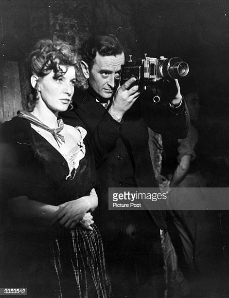 David Lean directs actress Kay Walsh as Nancy in Lean's film version of 'Oliver Twist'. Original Publication: Picture Post - 4464 - Has Lean Done It...