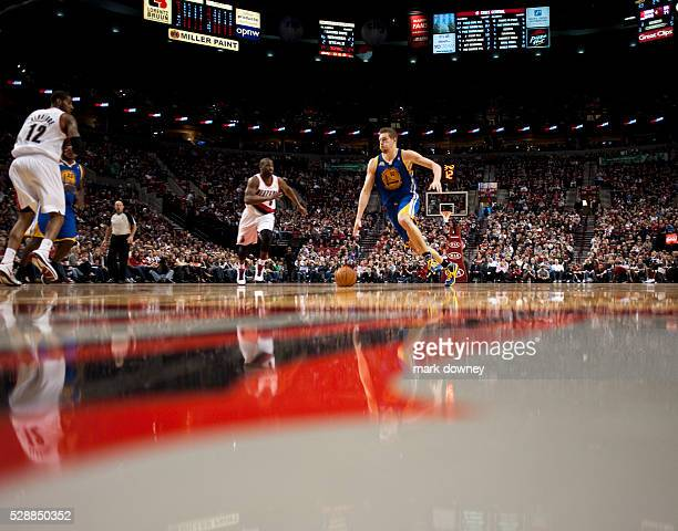 David Lee a Golden State Warrior dribbles down the court at a game versus the Portland Trail Blazers The Trail Blazers won 90 to 87