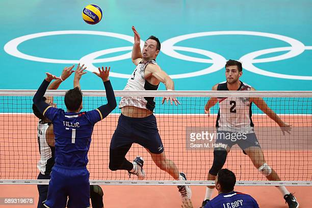 David Lee and Aaron Russell of United States compete against Kevin Tillie and Nicolas le Goff of France during a Men's Preliminary Pool B match on...