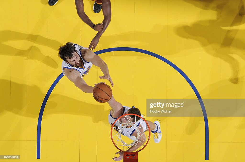 David Lee #10 and Andrew Bogut #12 of the Golden State Warriors secure the rebound against the Cleveland Cavaliers on November 7, 2012 at Oracle Arena in Oakland, California.