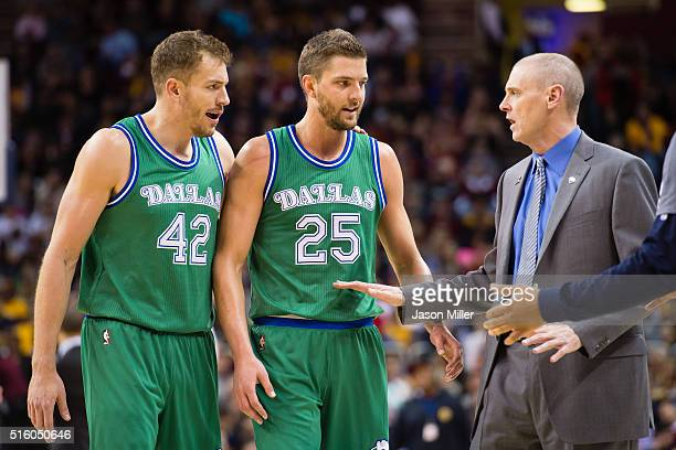 David Lee and Chandler Parsons listen to Rick Carlisle of the Dallas Mavericks as they walk off the court for a timeout during the first half against...