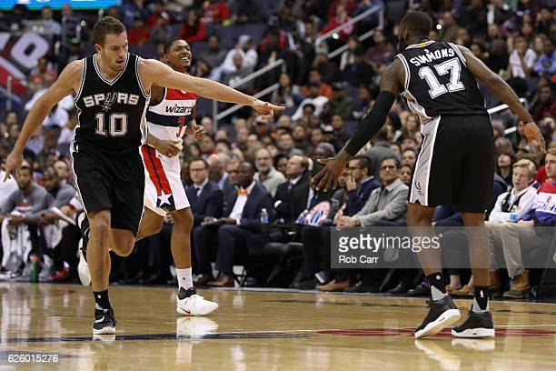 David Lee and Jonathon Simmons of the San Antonio Spurs celebrates in front of Bradley Beal of the Washington Wizards after scoring at Verizon Center...