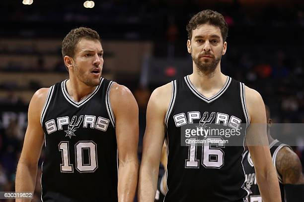 David Lee and Pau Gasol of the San Antonio Spurs during the first half of the NBA game against the Phoenix Suns at Talking Stick Resort Arena on...