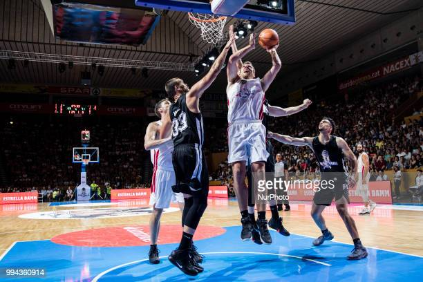 David Lee from United States of America exSan Antonio Spurs player defended by Marc Gasol from Spain of Memphis Grizzlies during the charity and...