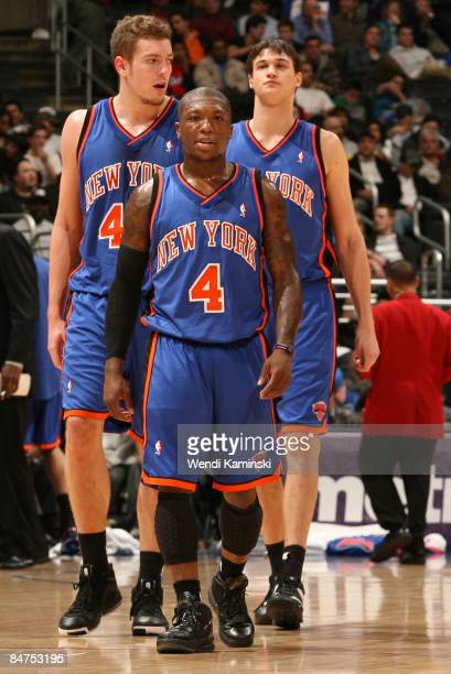 David Lee Nate Robinson and Danilo Gallinari of the New York Knicks look on during their game against the Los Angeles Clippers at Staples Center on...