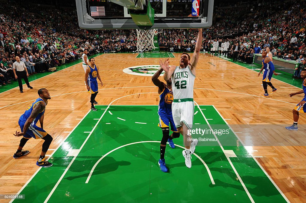David Lee #42 of the Boston Celtics goes to the basket against the Golden State Warriors on December 11, 2015 at the TD Garden in Boston, Massachusetts.