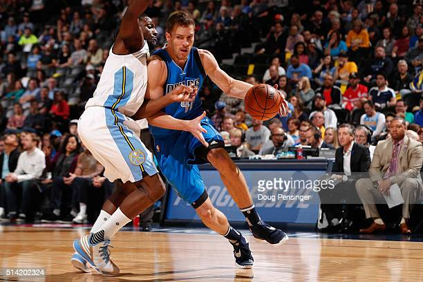 David Lee of the Dallas Mavericks controls the ball against Kenneth Faried of the Denver Nuggets at Pepsi Center on March 6 2016 in Denver Colorado...