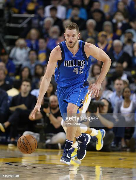 David Lee of the Dallas Mavericks dribbles the game against the Golden State Warriors at ORACLE Arena on March 25 2016 in Oakland California NOTE TO...