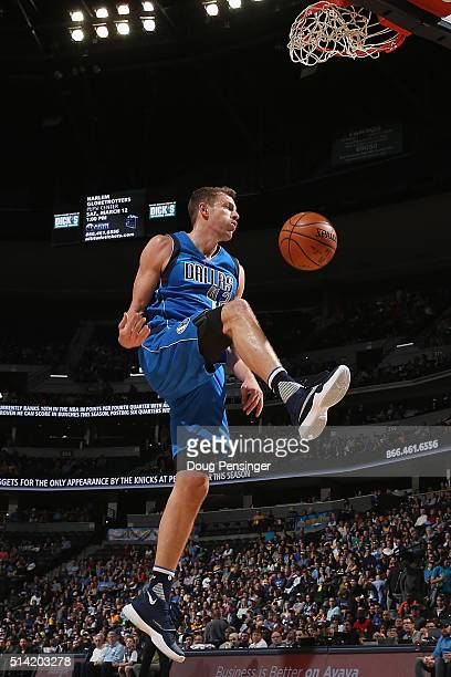 David Lee of the Dallas Mavericks dunks the ball against the Denver Nuggets at Pepsi Center on March 6 2016 in Denver Colorado The Nuggets defeated...