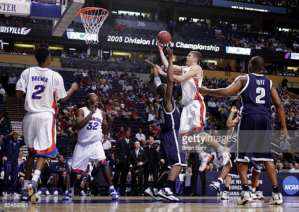 David Lee of the Florida Gators goes through Will Sheridan of the Villanova Wildcats on his way to the basket in the second round of the NCAA...